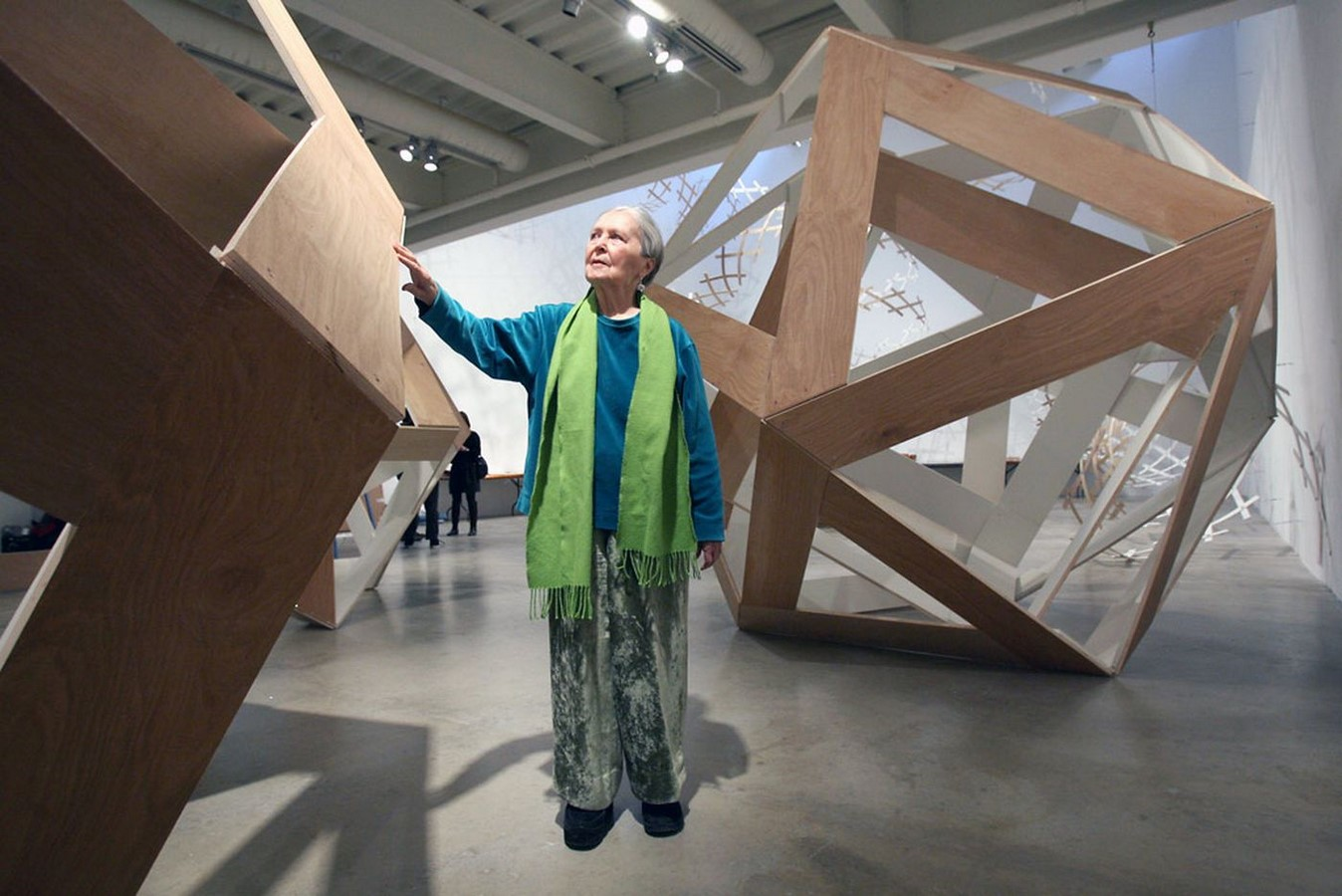 Anne Tyng pictured with large sculptures of geometries